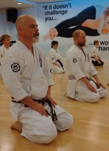 Adults karate kneeling ready